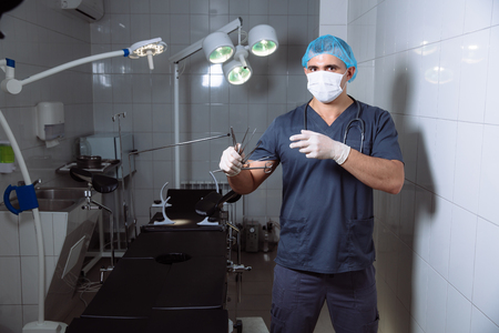 Surgeon holding medical instruments in hands. Concept of healthy Stock Photo