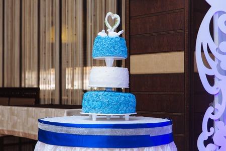 multilevel: Multilevel wedding cake. Sweet cake in white and blue colour Stock Photo