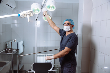 physicals: Surgeon holding medical instruments in hands. Concept of healthy Stock Photo