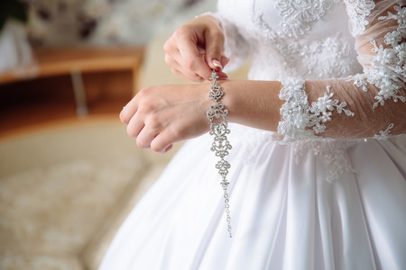 hands of the bride with the bracelet Stock Photo