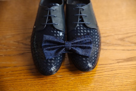 suit  cuff: mens accessories, bowtie, shoes, strap on the table