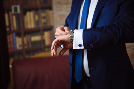 cuff link: Groom hands with cufflinks and watches. Elegant gentleman clother, white shirt