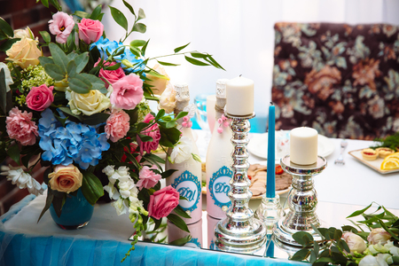 Wedding decorated table with candles and champagne in the tenderly light blue style Stock Photo
