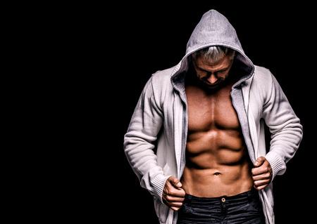 nipple man: strong athletic man on black background