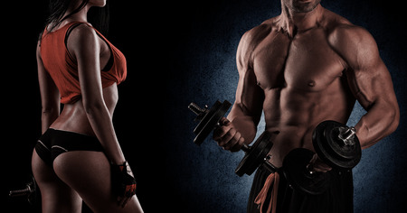 gym: young beautiful couple, bodybuilding, posing in front of the camera, sexy, strong