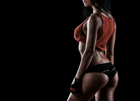 fit: beautiful woman on a dark background is engaged in fitness Stock Photo