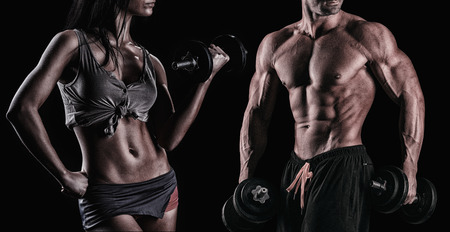 athletic beautiful sexy young couple posing in studio Stock Photo