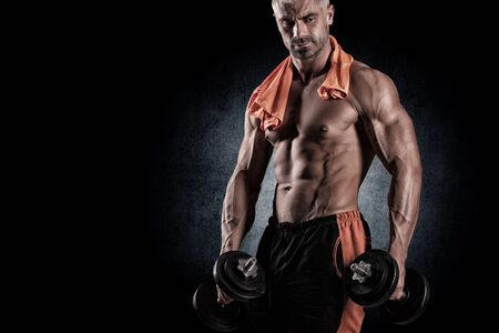 hand hold: with dumbbells over black background