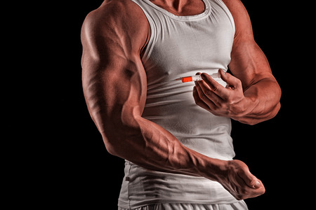 immunize: muscular man doing a shot in the biceps, steroids, pharmacology