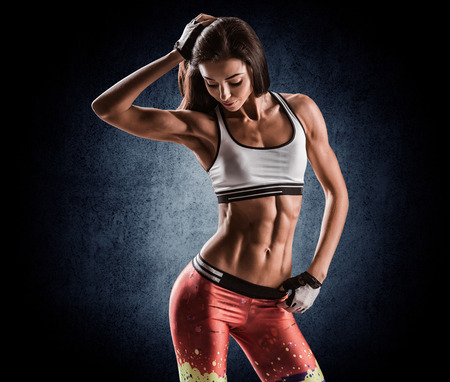 slim tummy: beautiful young athletic girl after workout Stock Photo