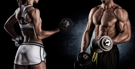 beautiful young sporty couple doing exercises with dumbbells