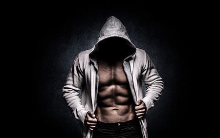 dark background is engaged in fitness Standard-Bild