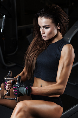 sport fitness: Fitness woman in sport wear with perfect fitness body resting in gym