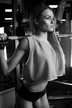 stride: Beautiful brunette during workout in gym