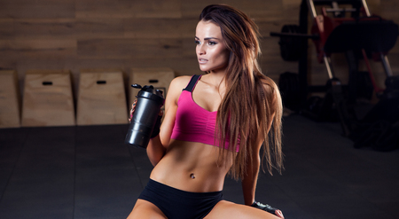 Sporty muscular woman drinking water photo set of sporty muscular female brunette girl