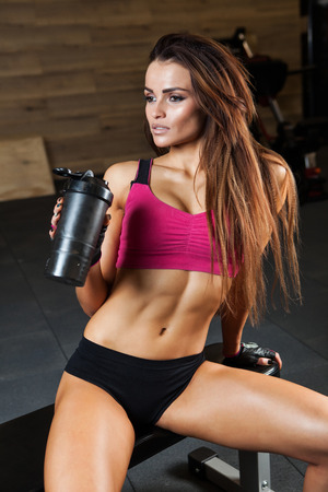 woman working out: Sporty muscular woman drinking water photo set of sporty muscular female brunette girl
