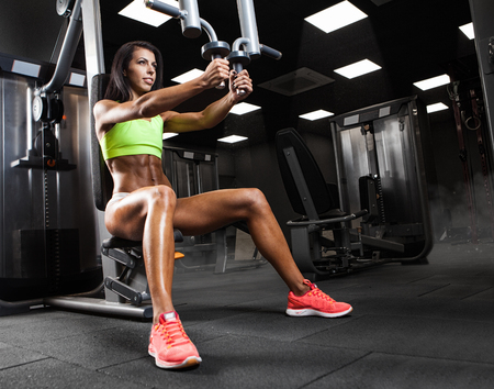 woman diet: Athletic young lady doing workout with weights Stock Photo