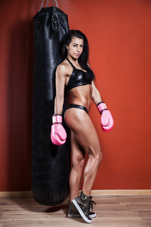 young and fit female fighter posing in combat poses Imagens