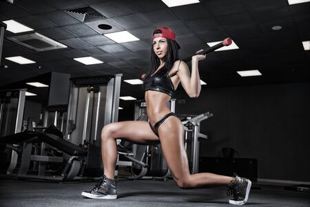 tough girl: beautiful girl bodybuilder, execute exercise with weight Stock Photo