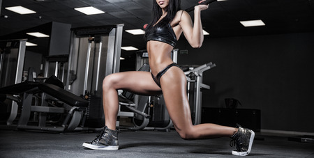 musculation: beautiful girl bodybuilder, execute exercise with weight Stock Photo
