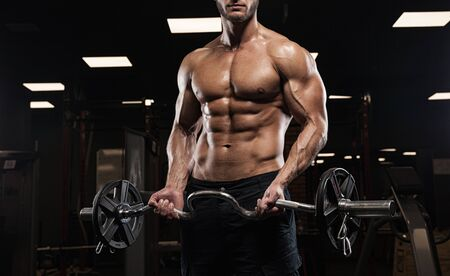 pectoral: handsome bodybuilder works out pushing up excercise in gym