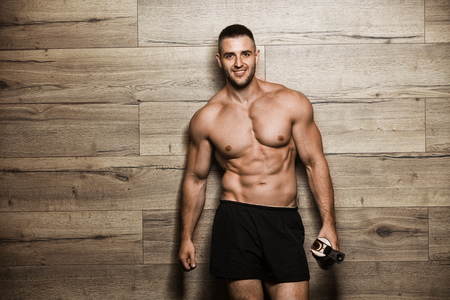 lift hands: Handsome man with big muscles, posing at the camera