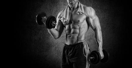 Closeup of a muscular young man lifting weights Stock Photo