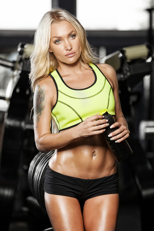 girl shows athletic body Stock Photo
