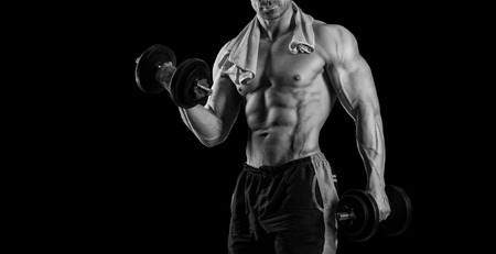 male body: Closeup of a muscular young man lifting weights Stock Photo