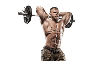 abdominal fitness: Atlética muscular del gimnasio culturista modelo posando después de ejercicios en el gimnasio Foto de archivo