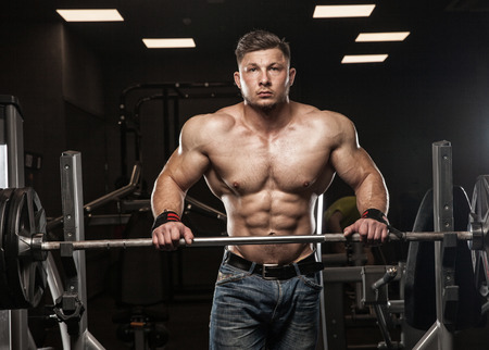 latissimus: posing after exercises in gym