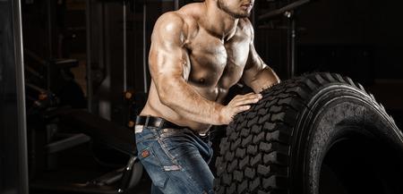 latissimus: Muscular athletic bodybuilder fitness model posing