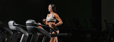 Pretty girl working out in a treadmill at the gym