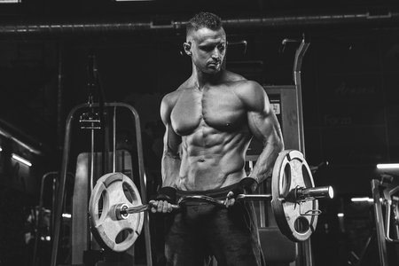 Young handsome sportsman bodybuilder weightlifter with an ideal body Stock Photo