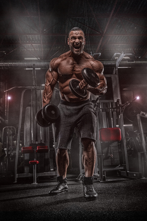 Strong bodybuilder with six pack, perfect abs, shoulders, biceps, triceps and chest Stock Photo