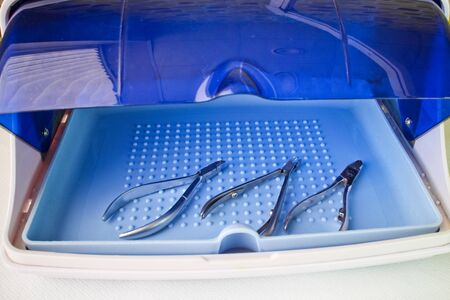 UV sterilizer with manicure and pedicure tools