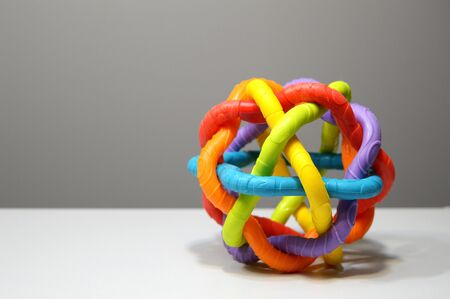 abstract multicolored round large rubber wire ball  to illustrate the topic of communication, online education, a game of visual thinking and a toy to attract attention among preschoolers