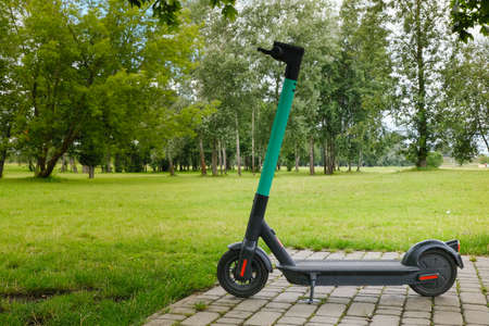 electric scooter - modern eco friendly public and private everyday transport parked on nature background ready for rent and online booking on app