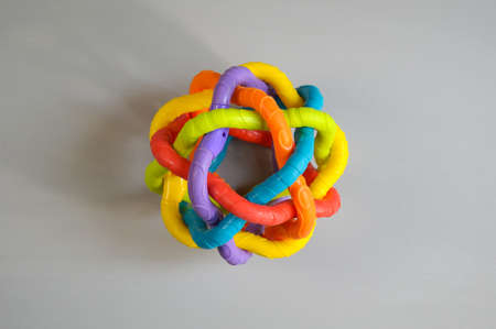 top view of baby educational toy- multi colored round large rubber wire ball