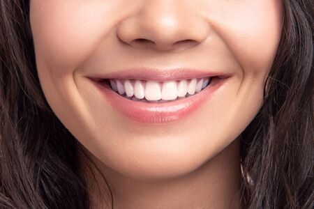 Closeup smile of young teen happy female woman great white teeth. Dental health. Stockfoto