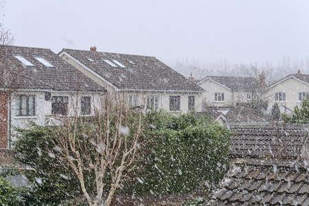 Beautiful heavy snowfall in Ballinteer,Southern Dublin, Ireland. Viewed form the window during coronavirus lockdown. Unusual Irish winter 2021. Traditional houses