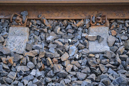 Beautiful closeup view of components of a railway track seen from Blackrock train station, Dublin, Ireland. Sleeper, weld, rail, ballast, fastening Banque d'images