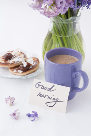 hyacinthus: Hyacinthus flowers in a transparent jar with god morning note, house candle holder and breakfast