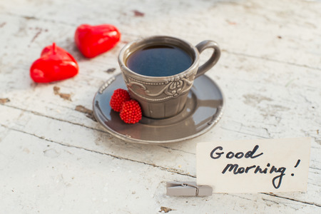 valentine day cup of coffee: Gray cup of coffee with some sweets and Good morning note, fot the St Valentines day