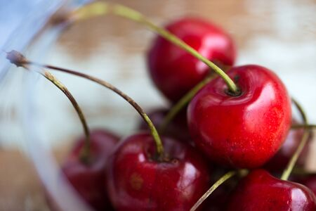 red cherries in a glass bowl