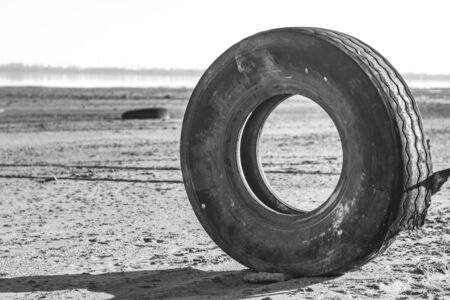 post-apocalyptic landscape. wheel from a truck on the beach