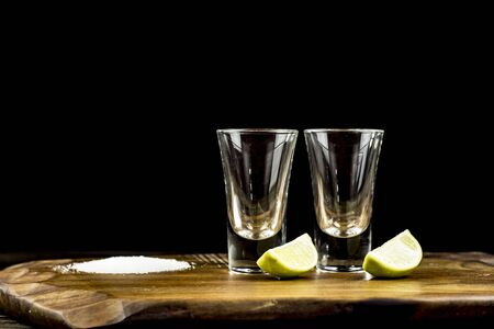 two glasses of tequila with lime and salt