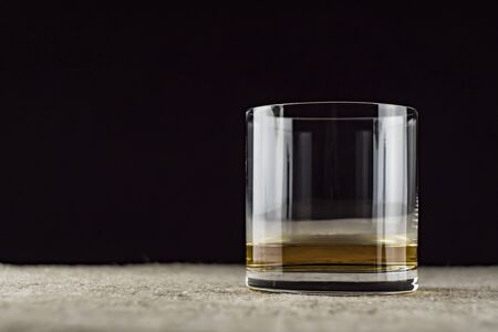 whiskey is poured into a glass 写真素材