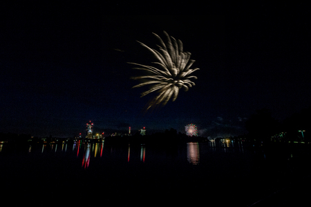 The festival of lights on the Old Danube in Vienna in summer with final fireworks