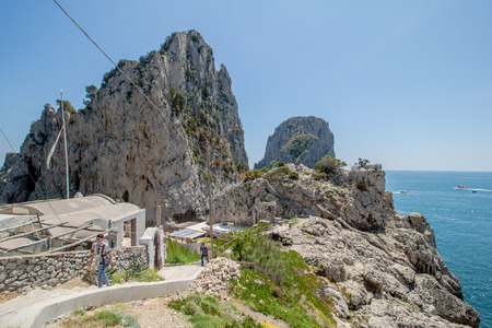 The well-known Faraglioni rocks in front of the island of Capri, Italy Imagens